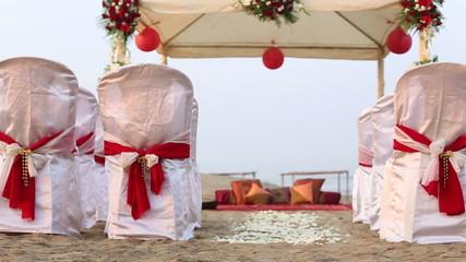 wedding decorated tent spectators seats rose petals on ocean san