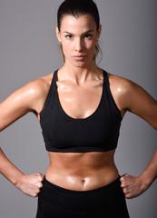 Woman, personal trainer, wearing black sportswear