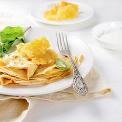 Fresh pancakes with honey for breakfast