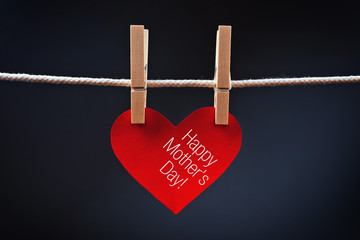 Happy Mother's Day printed on red heart