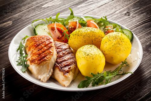 Fototapeta Fried chicken fillets, boiled potatoes and vegetable salad