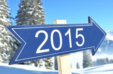 2015 arrow against snowy mountains