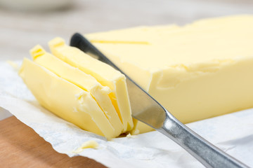 fresh butter in bar form and a knife