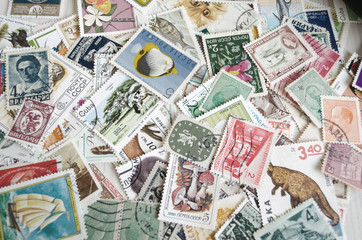 Backdrop of old postage stamps