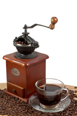 Retro manual coffee mill with a cup of coffee  isolated