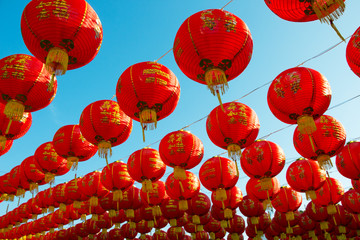 chinese lanterns over clear blue sky
