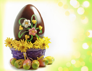 Chocolate easter egg decorated with fresh flowers