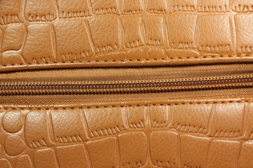 brown patent leather with a lock abstract background