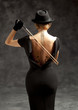 Woman in black plays violin