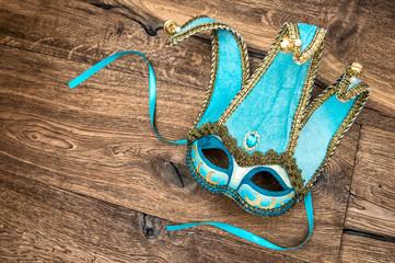 Blue carnival mask harlequin. Holidays background