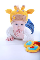 6-month girl in giraffe crochet hat