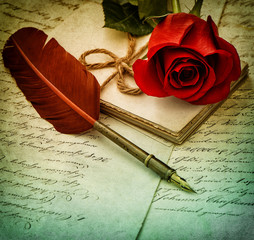 Old letters, rose flower and antique feather pen.  Vintage style