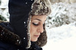 Pretty young woman with winter hat, outside portrait