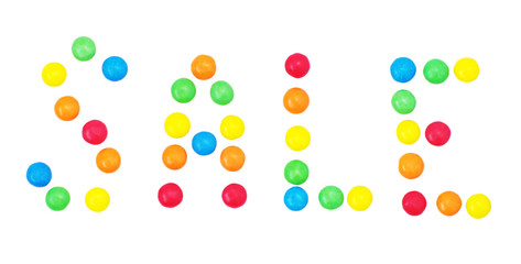 "Word "" Sale "" lined with colorful candy drops on white, isolated"