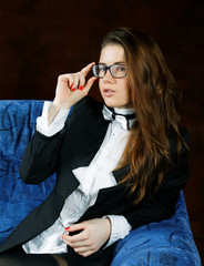 The girl with a tie-butterfly  and glasses