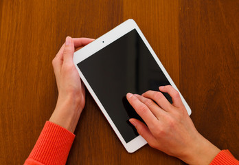 Female teen hands holding generic tablet