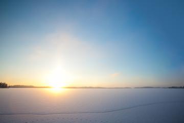 Frozen lake and sunset