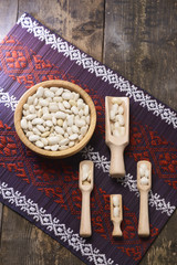 white beans in a wooden bowl