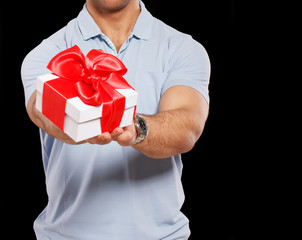 Nice man is holding little present