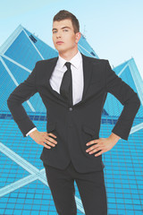 Well looking young businessman in front of skyscraper