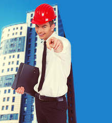 Young happy businessman is pointing with his finger