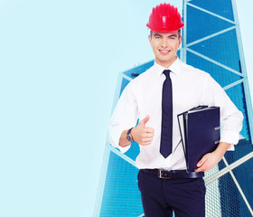 Successful young guy in a hardhat
