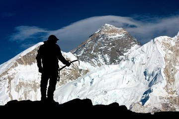 Mount Everest and silhouette of man - trek to everest base camp