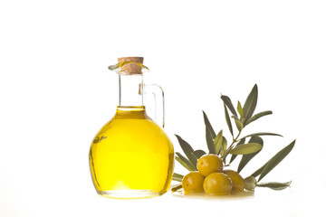 Extra olive oil bottle and olives