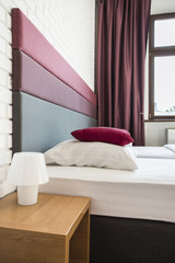 Bed with colourful headboard