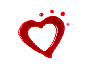 Isolated heart shaped blot from jam on white background