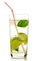 Glass of water with lime and mint isolated on white