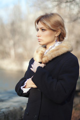Portrait of woman of last century at autumn day