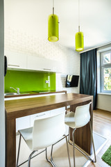 Kitchenette and dining space in hotel room