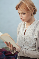 Portrait of woman from last century with book