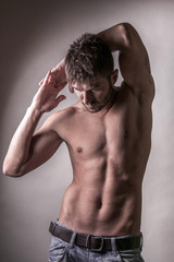 Sexy fashion portrait of a hot male model with muscular body