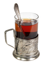 black tea in retro glass with teaspoon and glass-holder