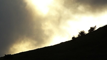 Mountain sunset dawn time lapse with yellow sky and clouds
