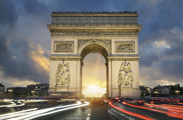 View of famous Arc de Triomphe at sunset