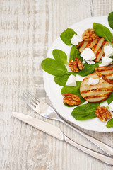spinach salad, roasted pears, white cheese and caramelized walnu
