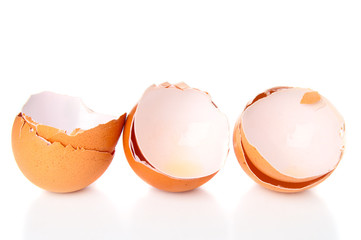 Cracked eggshells on white background