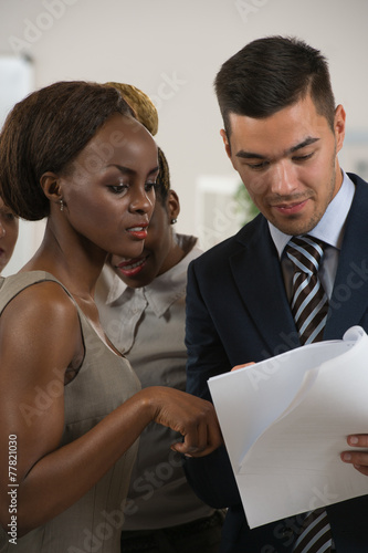 canvas print picture Image of business partners discussing documents and ideas at mee