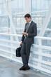 Handsome businessman using mobile smart phone
