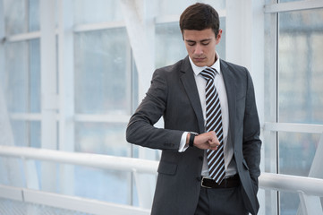 Businessman looking at watches