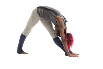 Young african woman doing yoga exercises