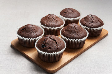 Chocolate muffins on the cutting board