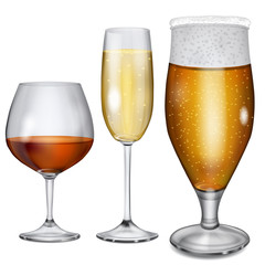 Transparent glass goblets with cognac, champagne and beer