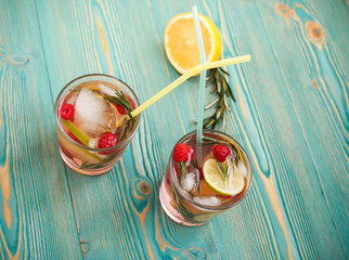 detox water in two cups with cocktail sticks