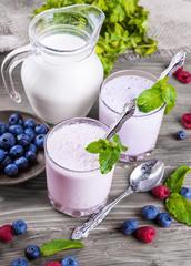 Milkshake with blueberries, raspberries and mint