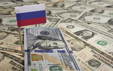 Flag of Russia sticking in various american banknotes.(series)