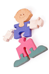 Colorful wooden boy puzzle pieces isolated on white